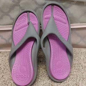 Pair of Crocs flip flops.